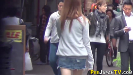 Young Asian girls shamelessly urinate in public