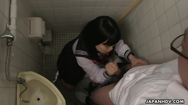 College girl gives a handjob in the restroom